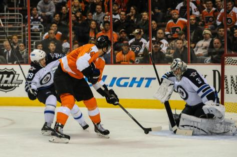 Sean Couturier puts the winning goal past Winnipeg's Ondrej Pavelec.